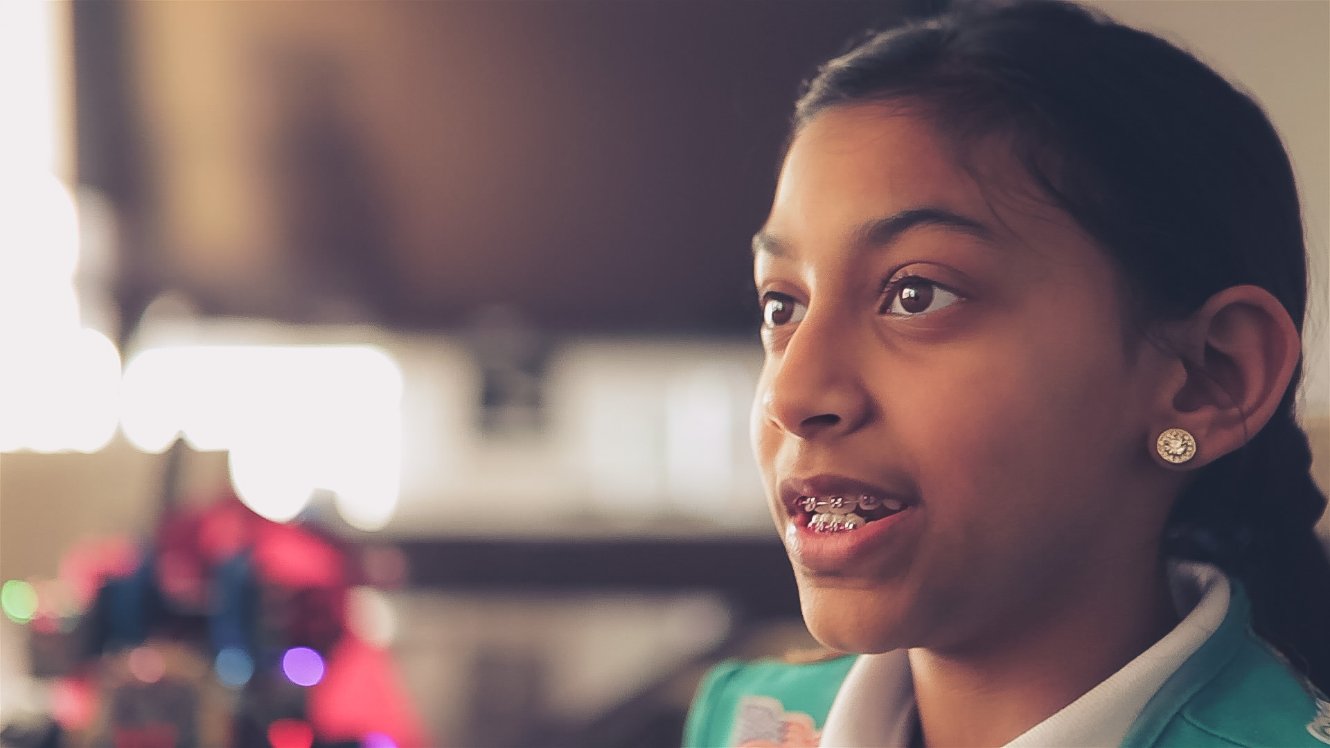 Girl Scout member smiling while being interviewed for video